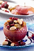 Baked apples stuffed with raisins, almonds and cranberries with honey