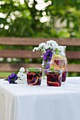 White wine sangria with summer fruits on a garden table