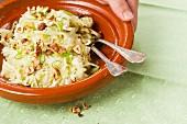 Vegan sauerkraut and raw vegetable salad with apples and hazelnuts