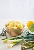 Ingredients for a pasta dish with asparagus, lemon, leek and lavender