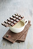 Bars of chocolate and a cup of coffee