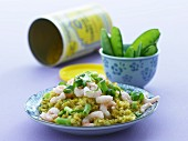 Curried rice with prawns, spring onions and mange tout