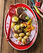 Fillet café de Paris with new potatoes and a carrot medley