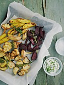 Oven-roasted vegetables with herb quark on a baking tray
