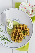 Spicy potato waffles with crème fraîche and chives