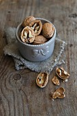 Walnuts, unshelled and cracked open