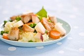 Chicken with apple, peas and carrots on mashed potatoes