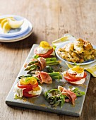 Green asparagus with Parma ham, caprese millefeuille and fried anchovies