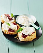 Scones with raspberry jam and sour cream