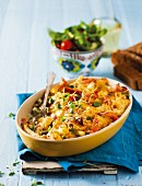 Pasta bake with Parmesan, bacon and vegetables