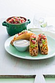 Chicken tacos with avocado salsa