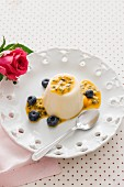 Panna cotta with passion fruit sauce and blueberries