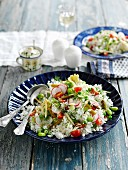 Rice salad with radishes, tomatoes, beans and gherkins