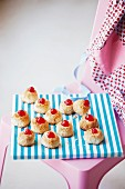 Coconut macaroons topped with glace cherries