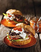 Sandwiches with slow cooked lamb, harissa and aubergines