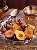 Caramelised roasted pears with cinnamon sticks