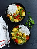Chicken curry with mange tout, peppers and rice