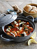 Fish soup with tomatoes, pawns and mussels