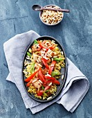 Rice with chicken, peppers, spring onions and pine nuts