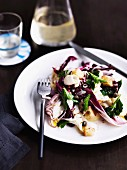 Salad of grilled baby calamari, radicchio and potatoes