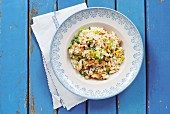 Seafood risotto with parsley, spring onions and peppers