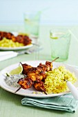 Curried chicken scewers with pilau rice and raita