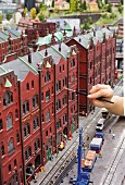 Miniatur Wunderland: a member of staff cleans the model houses of the Speicherstadt, Hamburg