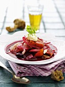 Beetroot soup with cabbage, carrots, onions, crème fraîche and chervil