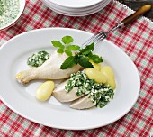 Poached chicken with a herb and egg sauce