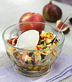 Fruit salad with homemade yoghurt ice cream