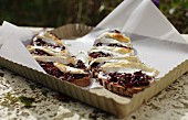 Country bread with red onion compote gratinated with goat's Camembert