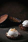 Homemade ice cream with coconut sugar in chocolate tartlet bases