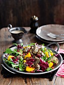 Lamb salad with yoghurt and pomegranate seeds