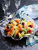 A mixed fruit salad in a crystal bowl