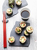 Vegan sushi made from almond, spelt sprouts and vegetables
