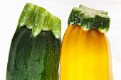 Flower stems on a green and yellow courgette