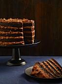 A layered chocolate cake, sliced