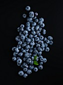Fresh blueberries on a black surface