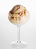 Caramel ice cream in tall glass