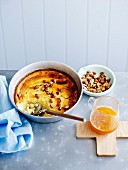Baked ricotta with honey, orange and almonds