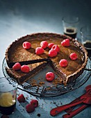Chocolate torte topped with raspberries