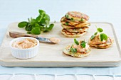 Blinis topped with trout and crab pâté and pea shoots