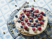 A pistachio cake with fresh berries