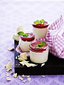 Panna cotta with white chocolate, raspberry sauce and pepper mint leaves