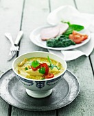 Yellow chicken curry and spinach with boiled ham