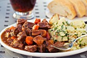Boeuf Bourguignon with potatoes and bread