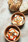Oven-roasted feta cheese with tomatoes, peppers and olive oil