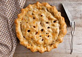 A homemade apple pie on a wood surface