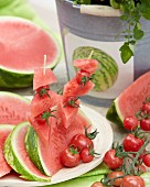 Watermelon wedges and melon and tomato skewers