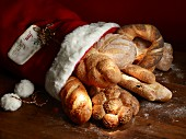 Various types of bread and bread rolls in a Christmas stocking